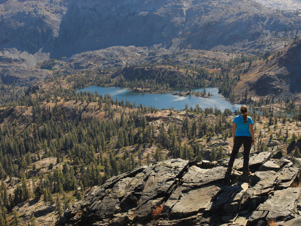 A hiker surveys Susie Lake from the Pacific Crest Trail in Desolation Wilderness