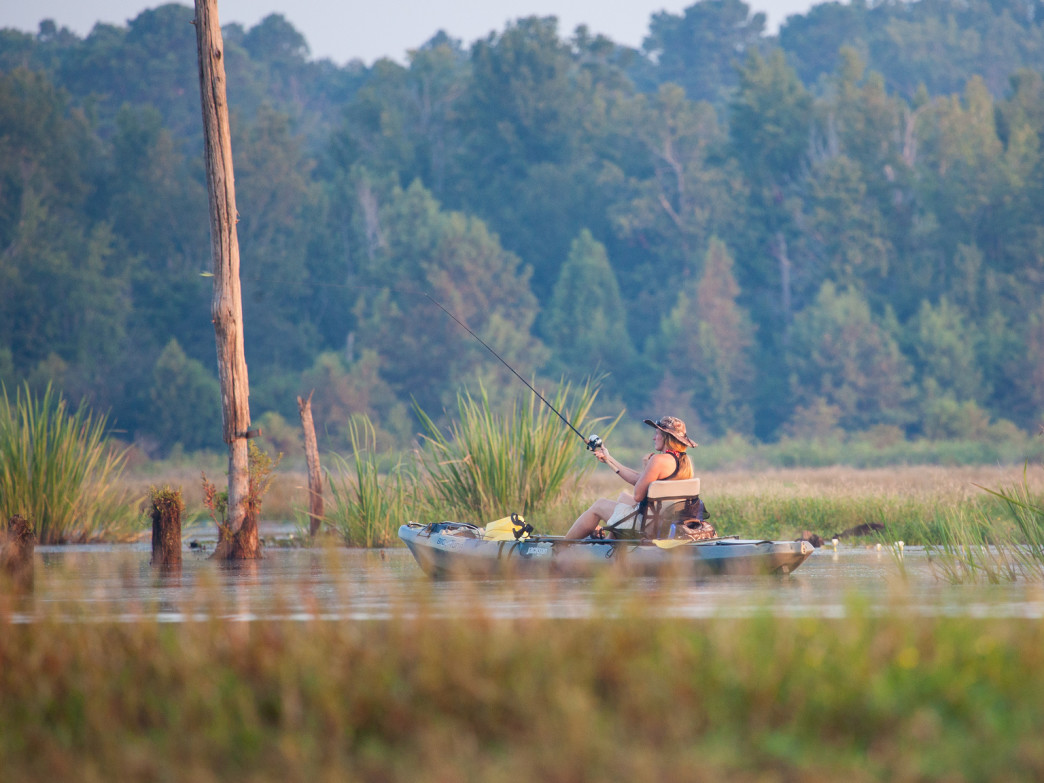 Kayak fishingcombines thepatient mediation of fishing with the steady athletic movement of paddling.
