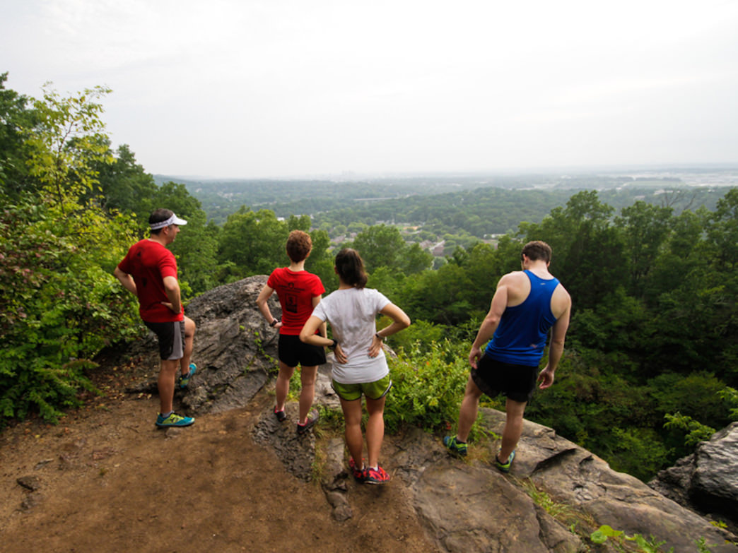 Members of the Birmingham Track Club take a break during their outdoor run at Ruffner Mountain.