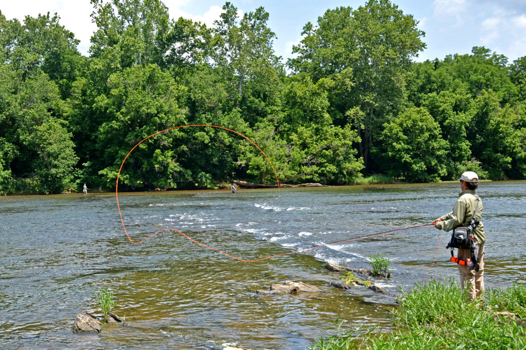 An angler casts from the bank of the South River.