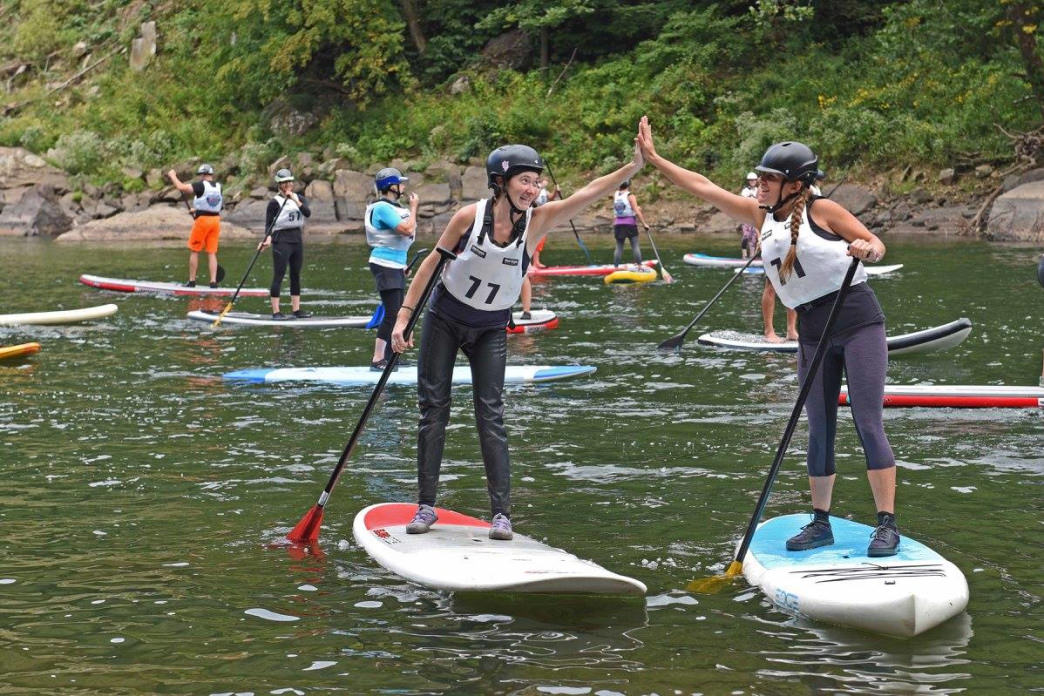 Celebrating with friends at the New River Gorge SUP Race.     Melanie Seiler Hames