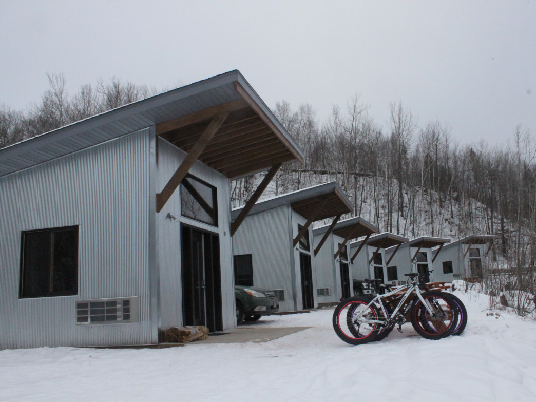 The cabins at the True North Basecamp offer excellent trail access for fat-tire bikers in the winter.