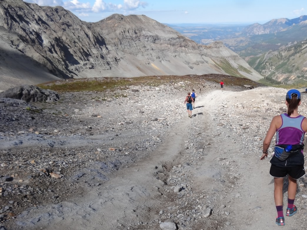 2014 Imogene Pass Run competitors begin the steep, loose descent from the top of Imogene Pass, 12,300 feet, toward Telluride, 8,750 feet.