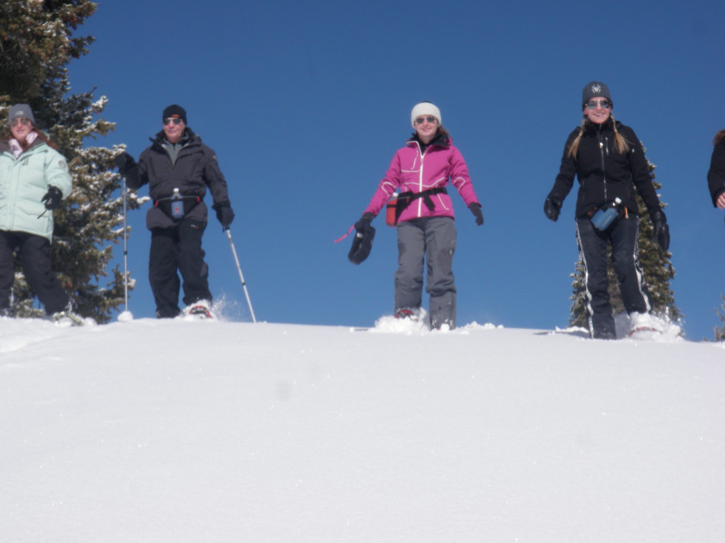 A bluebird day is perfect for winter snowshoeing tour.
