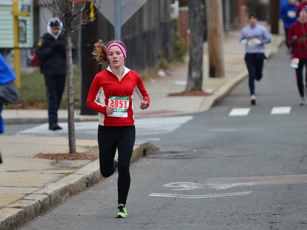 A lone runner pulls ahead in Somerville's Jingle Bell 5K.