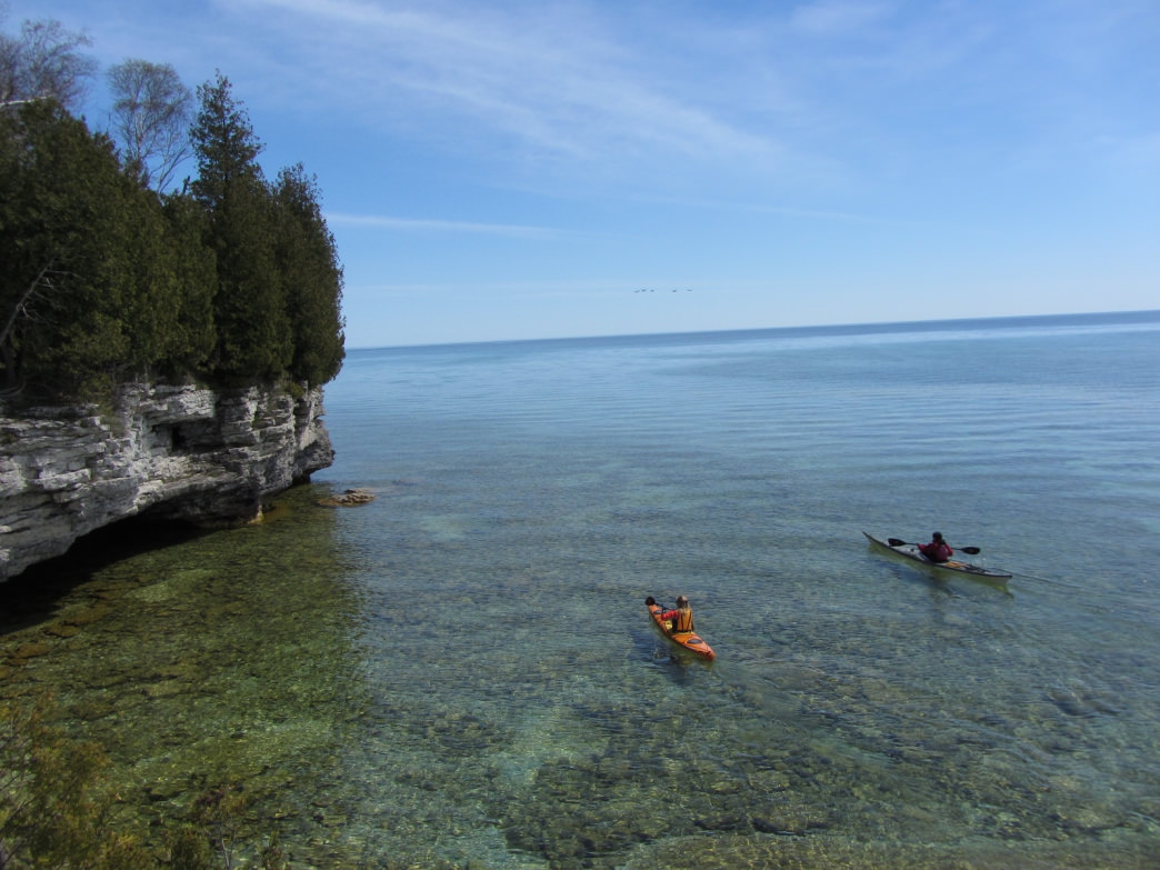 Kayaking over the glass-like surfaces of Lake Michigan.