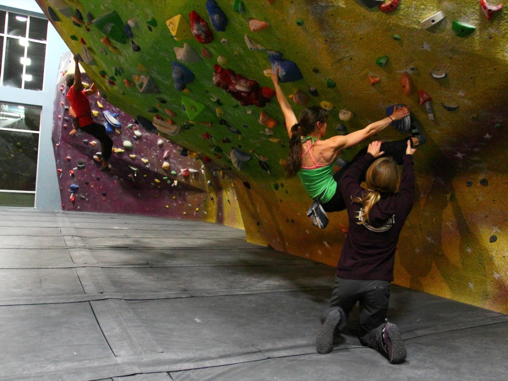 Lisa Rands instructing a young climber at High Point Climbing and Fitness