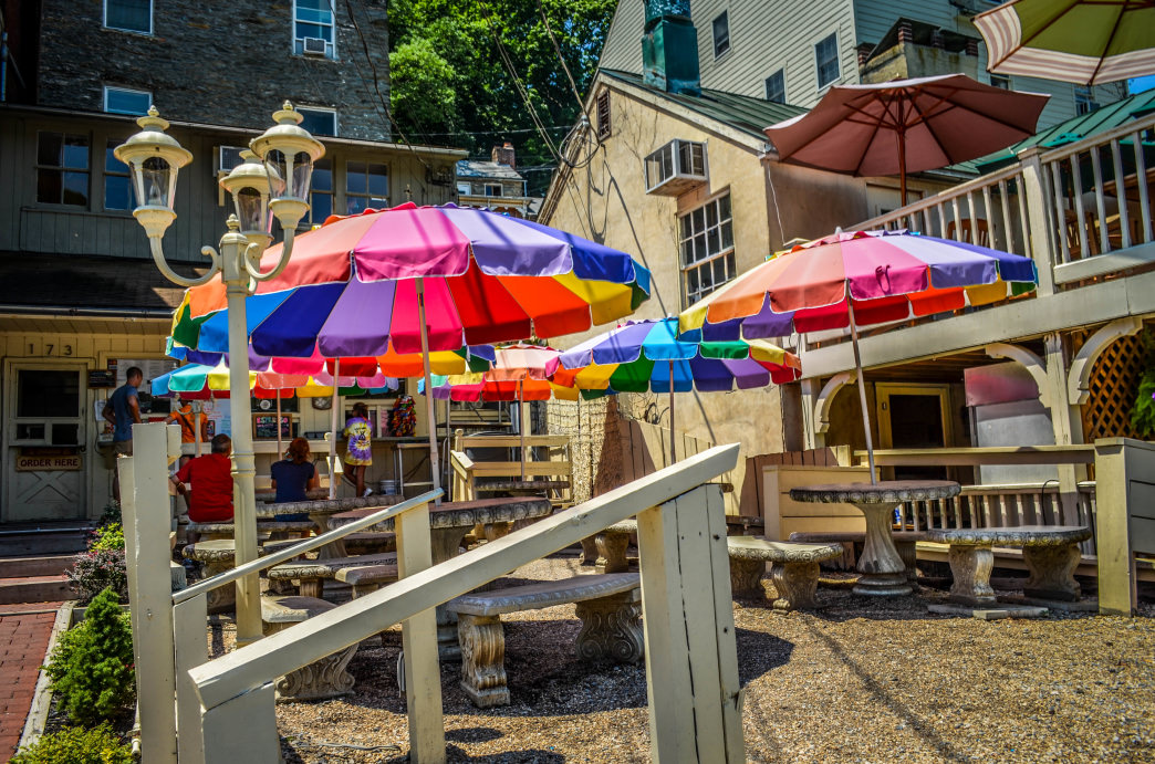 The colorful umbrellas surrounding Scoop's Ice Cream Shop in iconic Harper's Ferry.