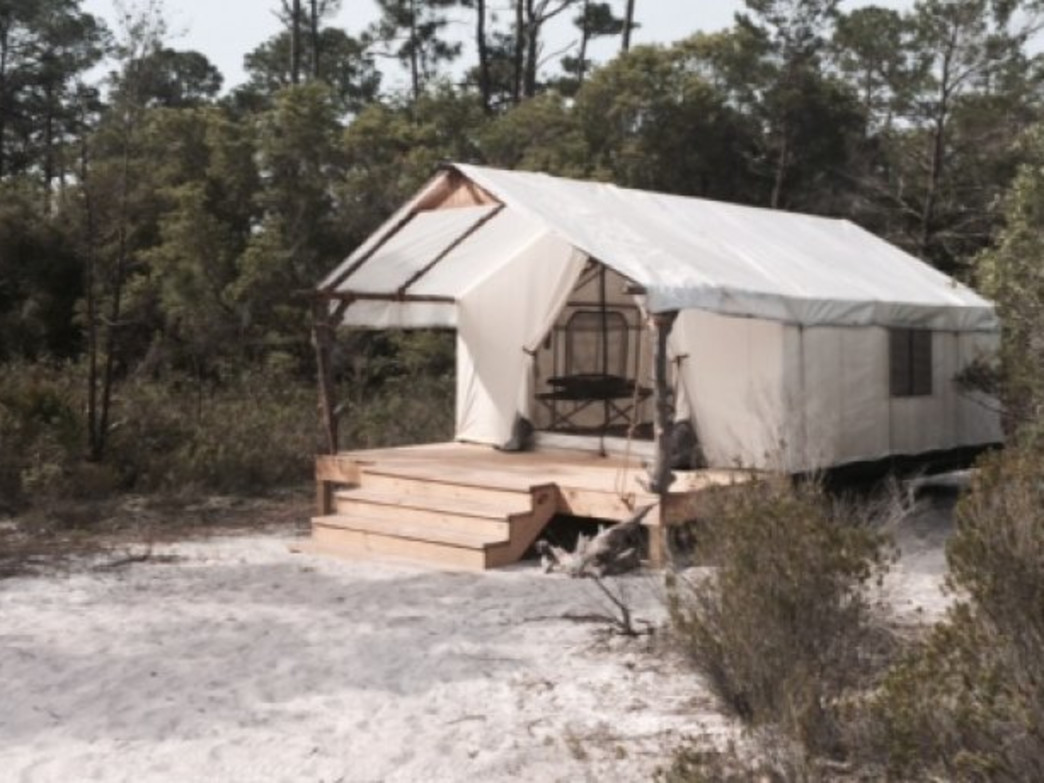 Primitive camping tents with four cots, water station and fire ring makes the camping experience easy at Gulf State Park's newest editions.