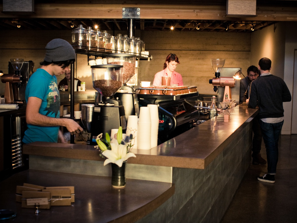 A barista pulling a shot of espresso at Sightglass Coffee.