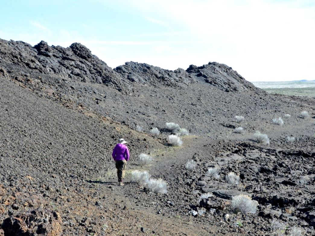 Jordan Craters offers a unique experience hiking on lava flows and exploring lava tubes. Hike it early in the day before it heats up.