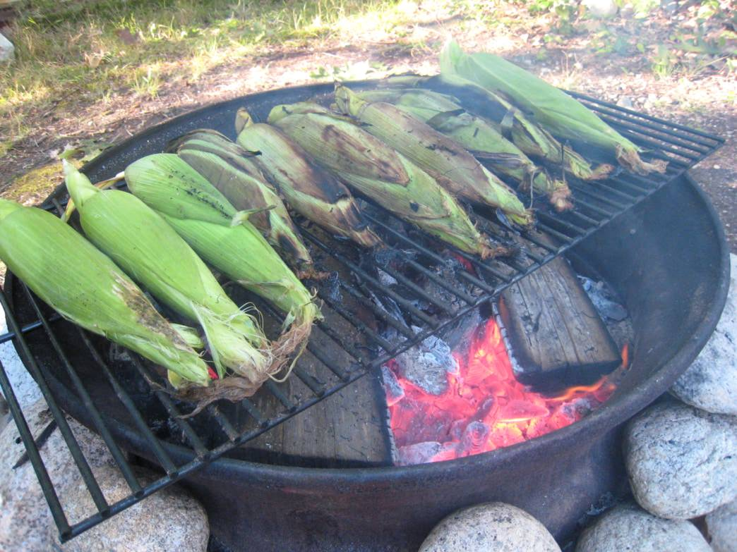 Nothing beats grilled corn straight off the campfire.