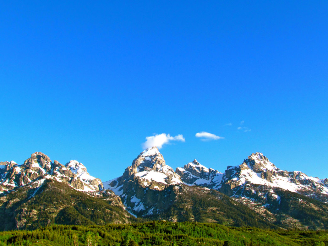 The jagged Tetons are one of many mountains to explore on the Rocky road trip.