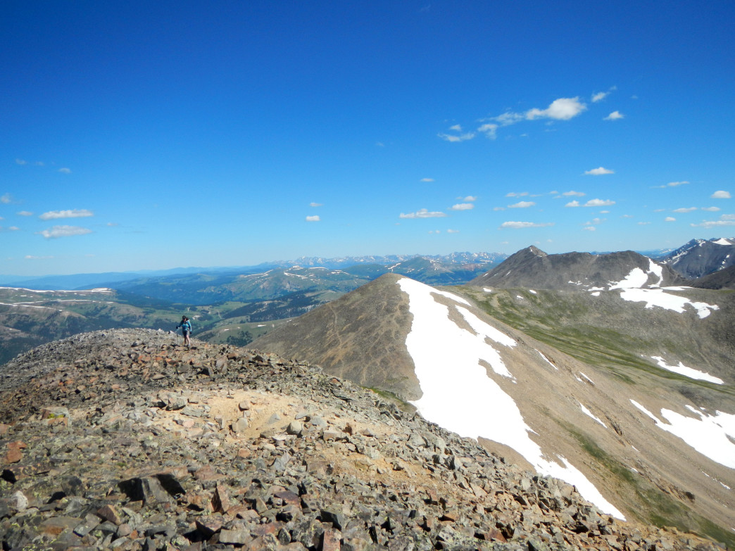 Approaching the summit of Mosquito Peak with Treasurevault Mountain in the background.
