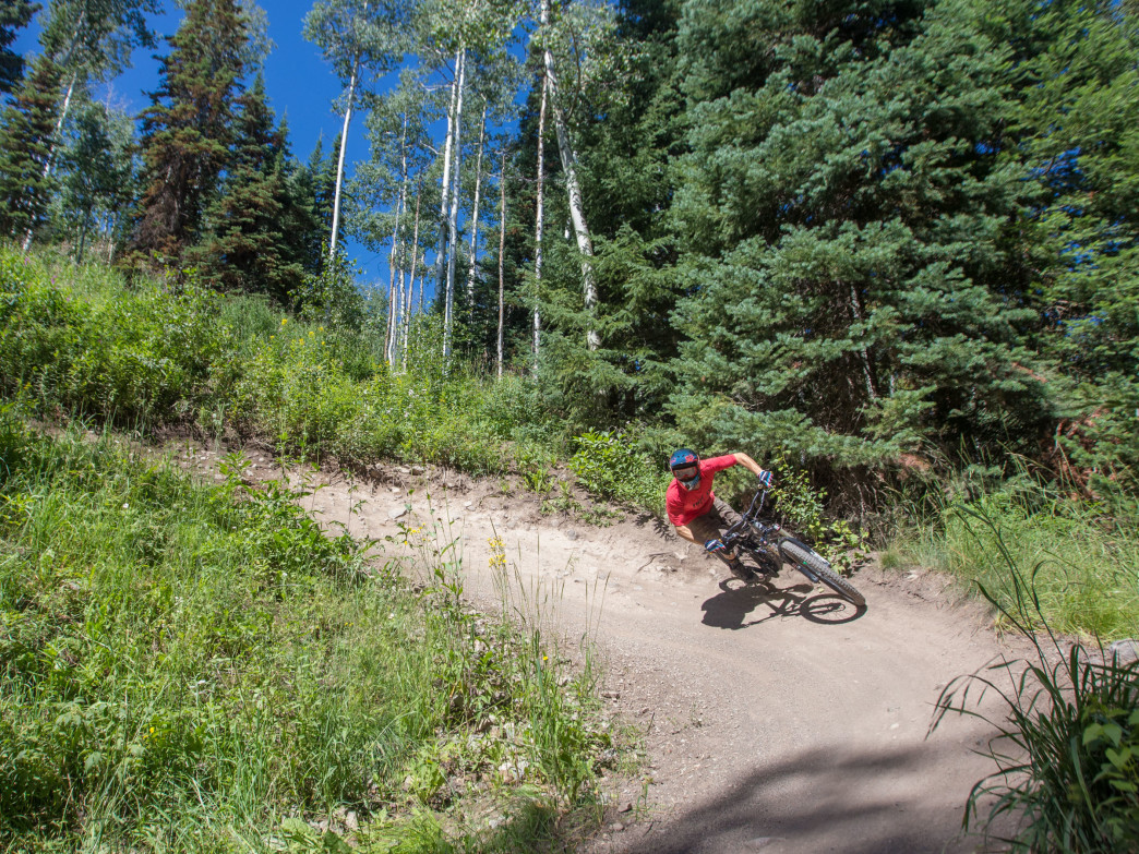 Steve Karczewski flies through a berm turn on the manicured flow trail on Snowmass.