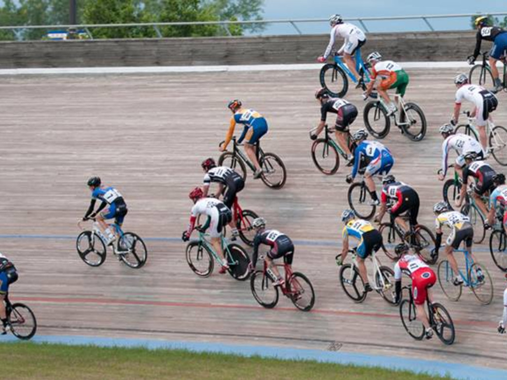Velodrome races can feature up to 24 cyclists on the track at once.