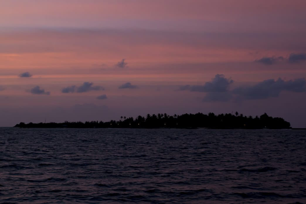 Watching island after island roll by at sunset after a world-class day of surfing the North Male Atoll. Drew Zieff