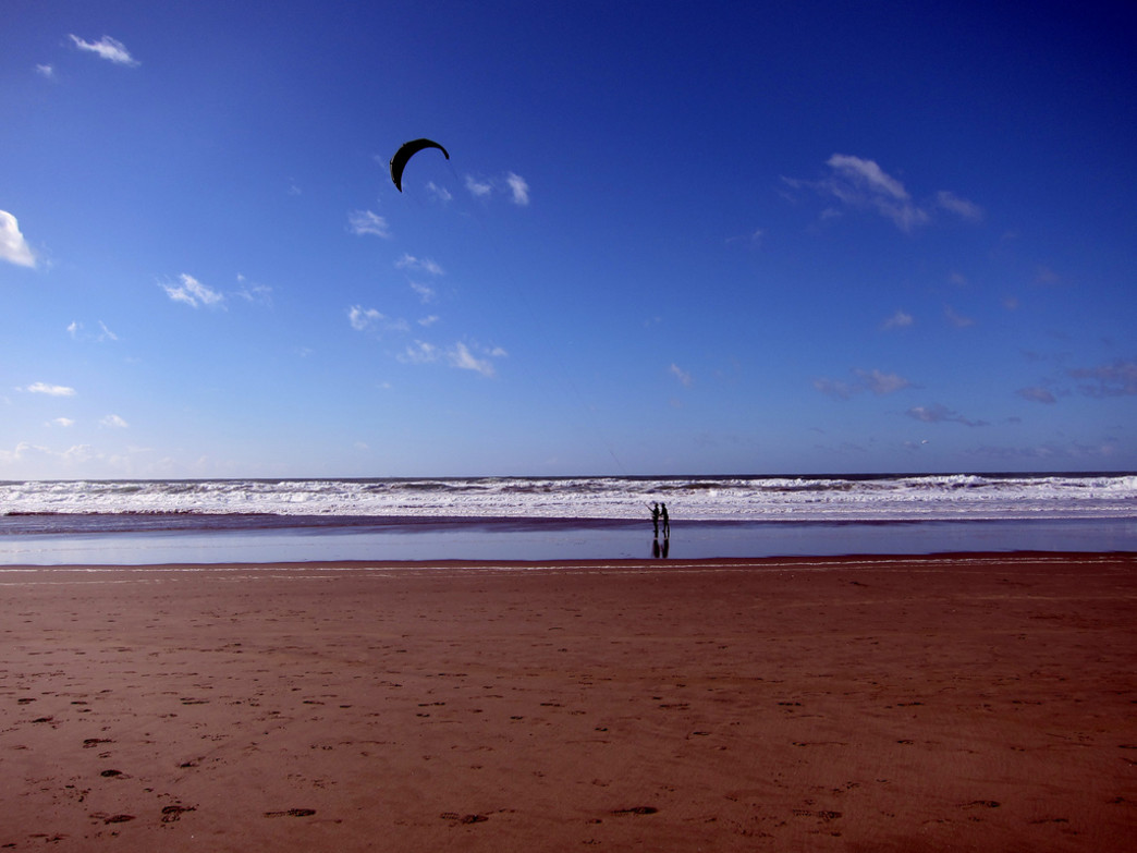 Kiteboarders take advantage of the wind at Ocean Beach.