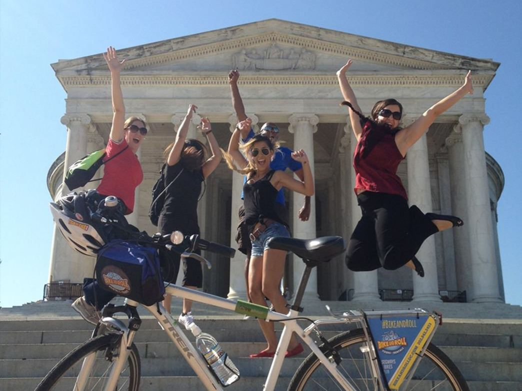 Happy bikers on Bike and Roll guided monument tour