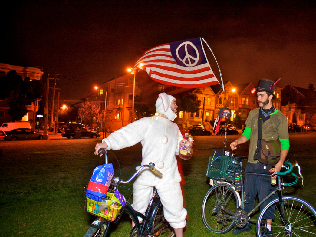 San Francisco Bike Party always promises a grand time on two wheels; just don't be as brazen as this guy with the booze.