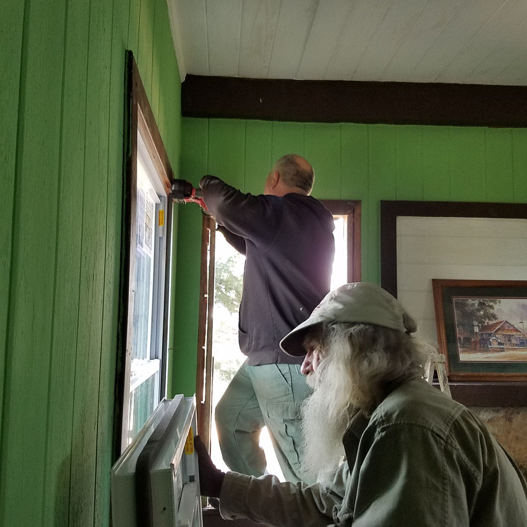 Eberhart, front, better known as Nimblewill Nomad, works with volunteer Craig Thornton to renovate the old CCC Cabins atop Flagg Mountain.