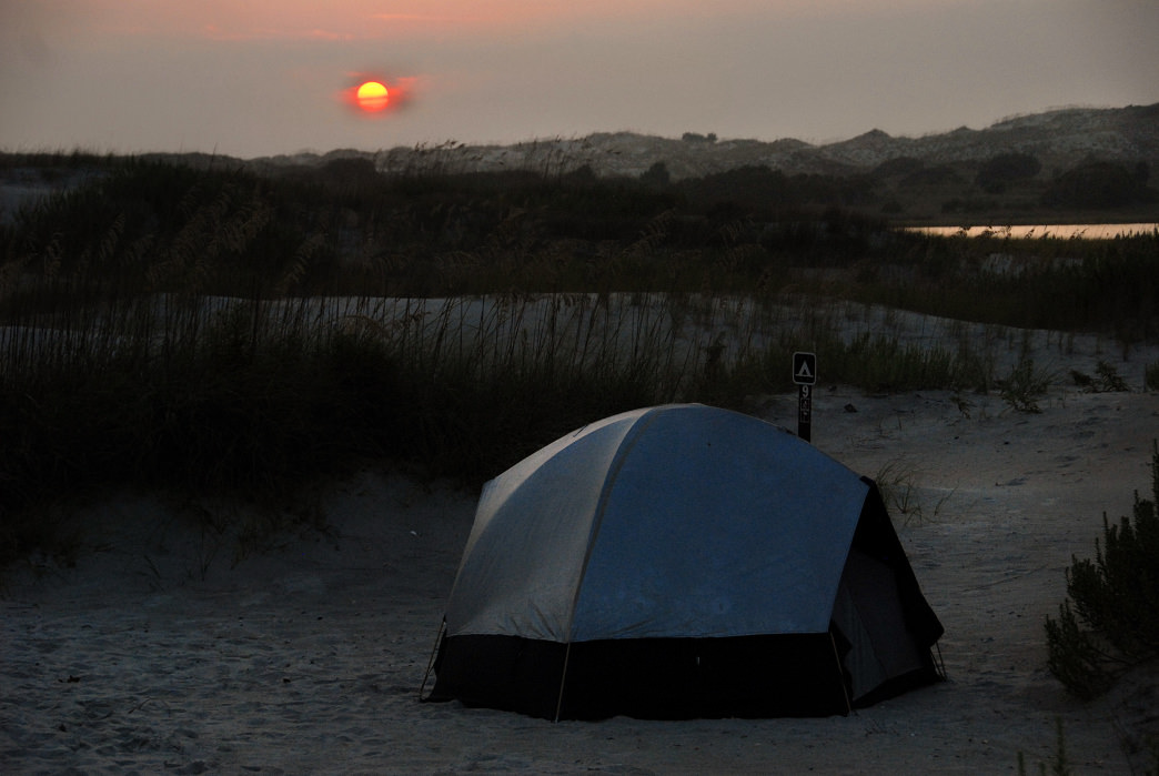 Tucked between huge dunes, Hammocks Beach State Park's paddle-in campground feels both hidden and open to the entire universe.