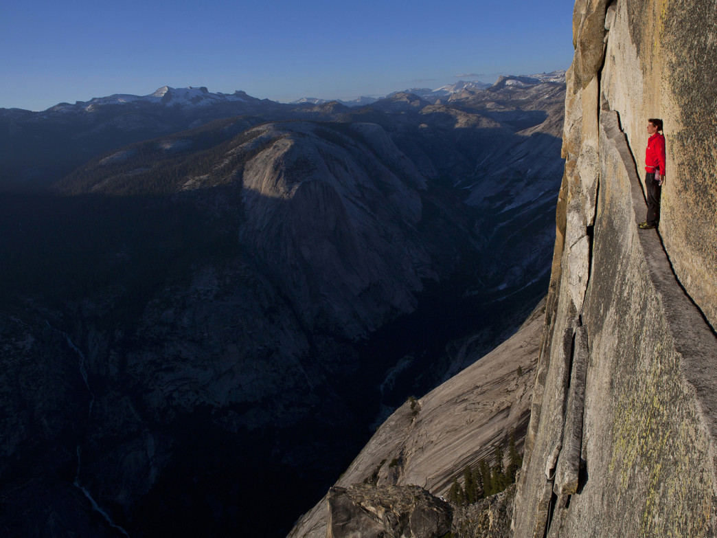 Alex Honnold reenacting his rope-less free climb of the 2,500 ft. Northwest Face of Half Dome (5.12), in Yosemite National Park.