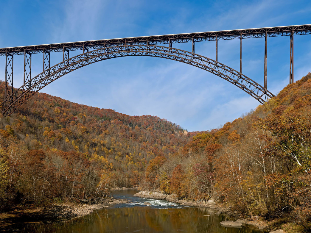 Passing under the New River Gorge Bridge is a highlight of any New River paddling trip.