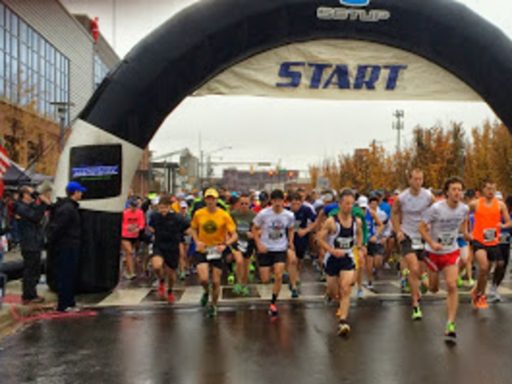 Runners launch from the starting line of the Magic City Half Marathon/5K.
