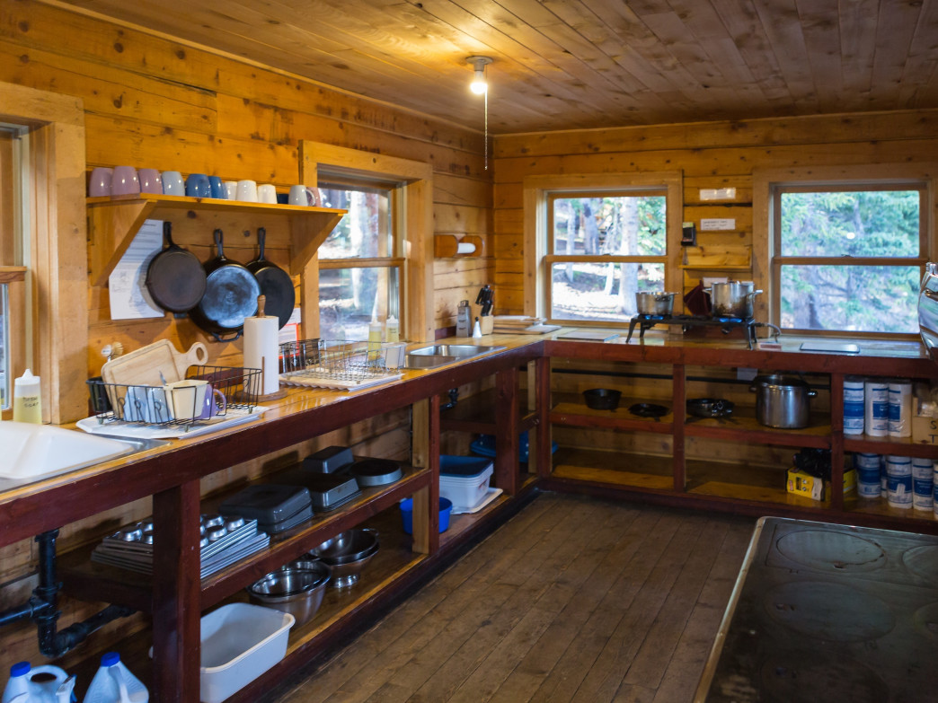 Hut kitchens are well stocked with dishes and cookware.