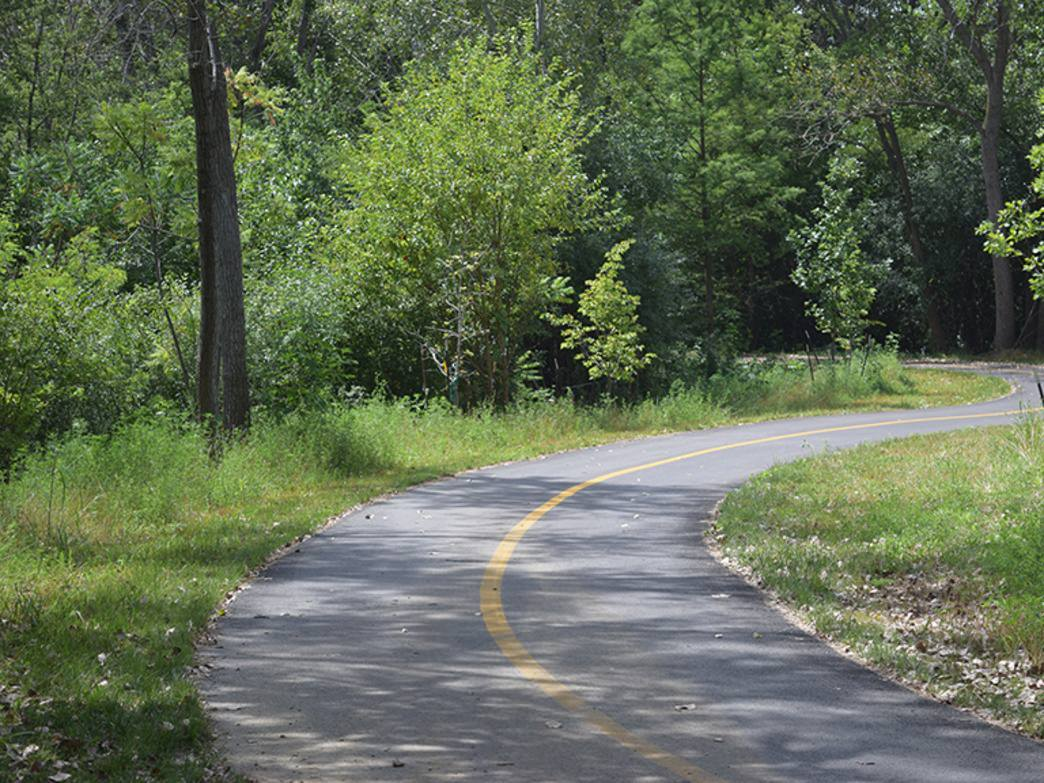 The smooth asphalt path makes the Cal-Sag Trail great for road bikes.