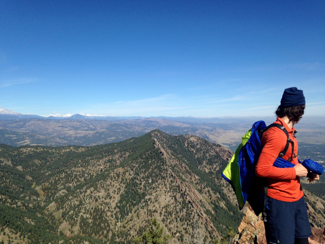 RootsRated CEO, Fynn Glover, admiring the view from Bear Peak