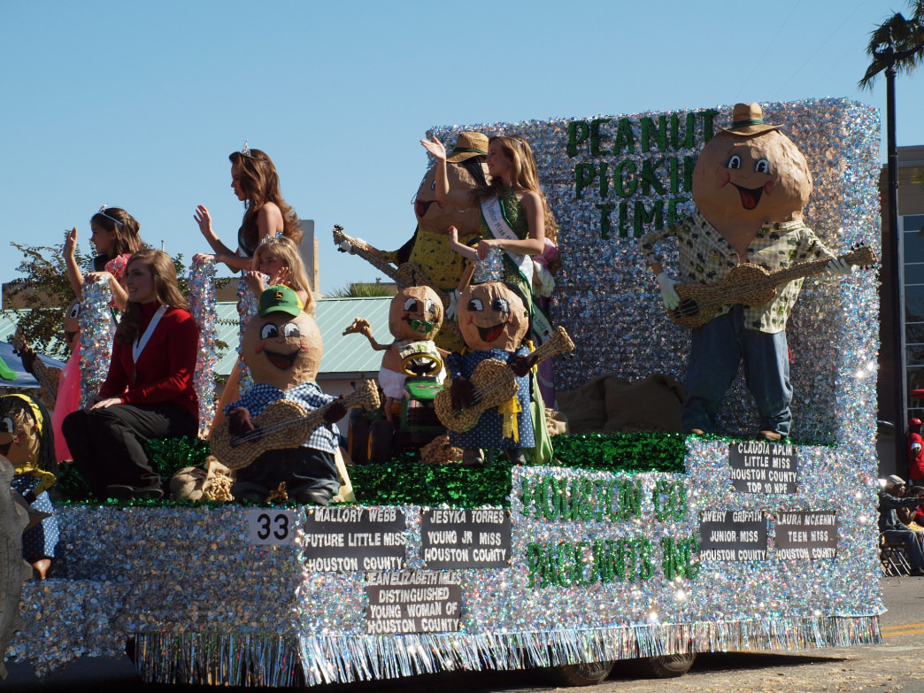 The festival includes a parade with floats that fit the theme.