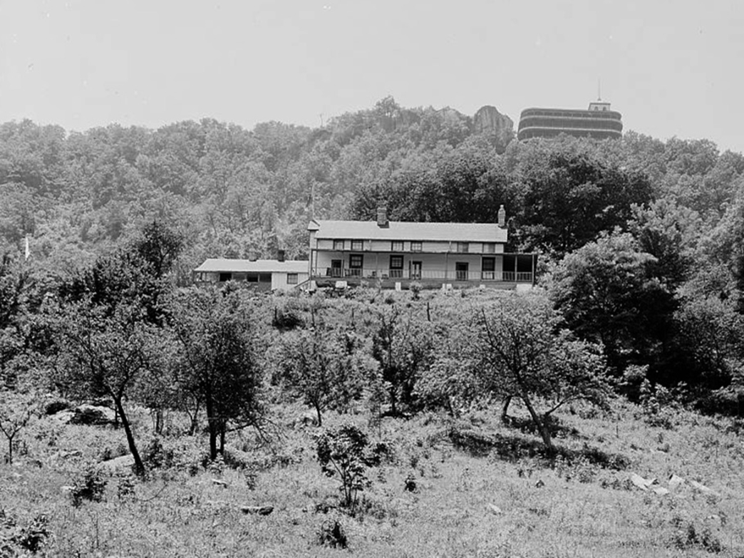 The Cravens House with the Point Hotel looming above, circa 1902.