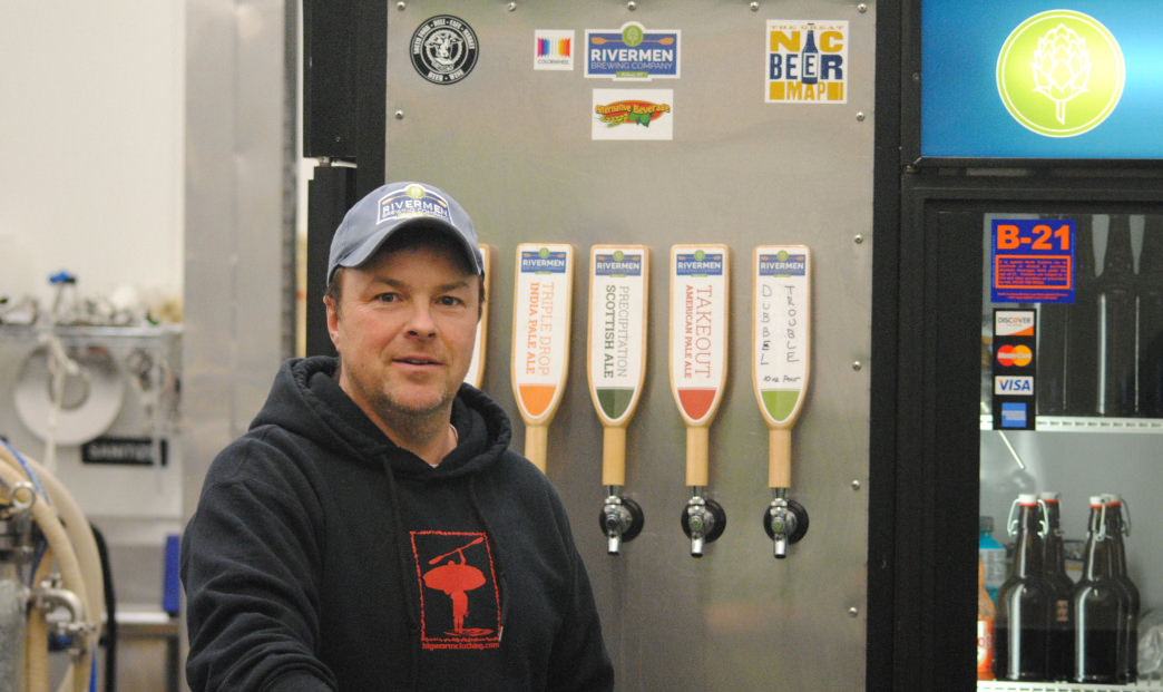 Pat Brennan of Rivermen Brewing stands in front of the five tap system at the old site. The new location for the brewery will have 24 taps, a farm to table restaurant, and tons of outdoor seating.