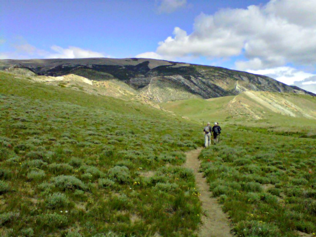 Hikers make their way along a trail to the aptly named Bald Ridge.
