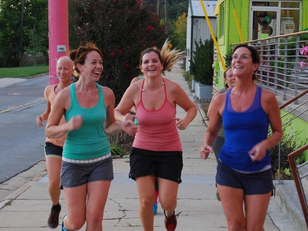 Judy Foy, left, leads a group run through the River Arts District.