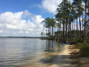 Launching a kayak at Wolf Bay on Portage Creek (the Gulf Coast Intracoastal Waterway).