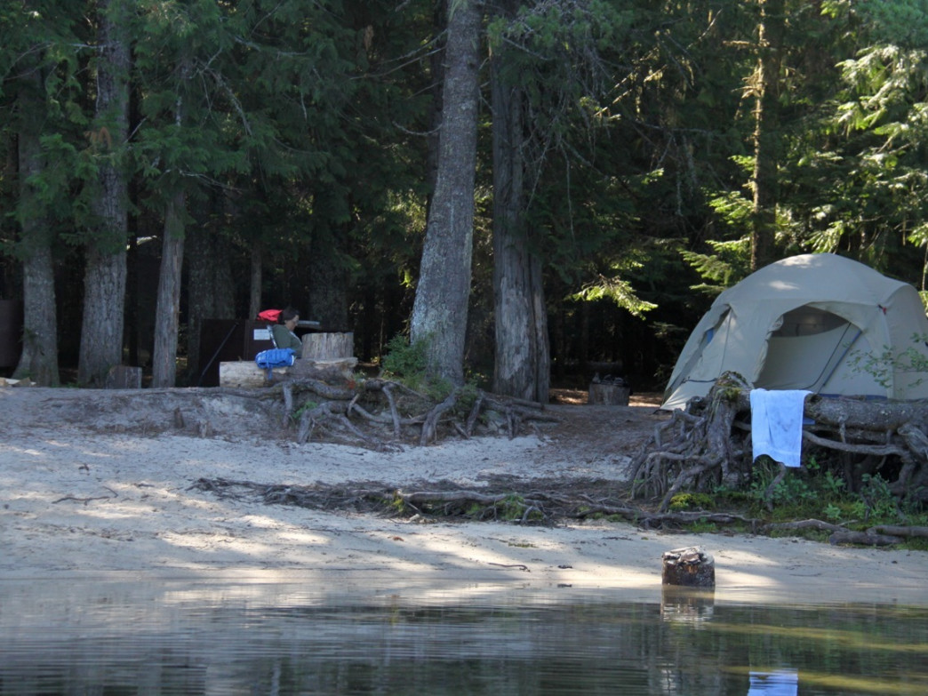 The first remote campsites along Upper Priest Lake are usually the busy ones. Paddlers who cross the lake have more solitude.
