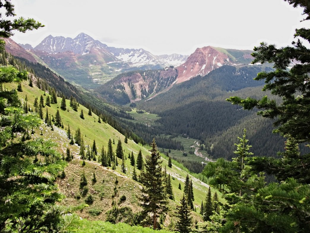 Four Pass literally climbs over four peaks in the  Maroon Bells/Snowmass Wilderness.