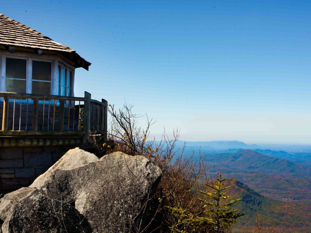 The Cammerer Lookout Tower offers panoramic views of the surrounding mountains.