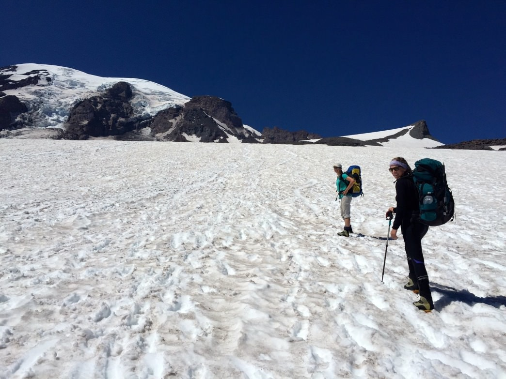 Climbers on the way to Camp Muir. Be prepared to protect yourself against the sun when it beats down against the snow!