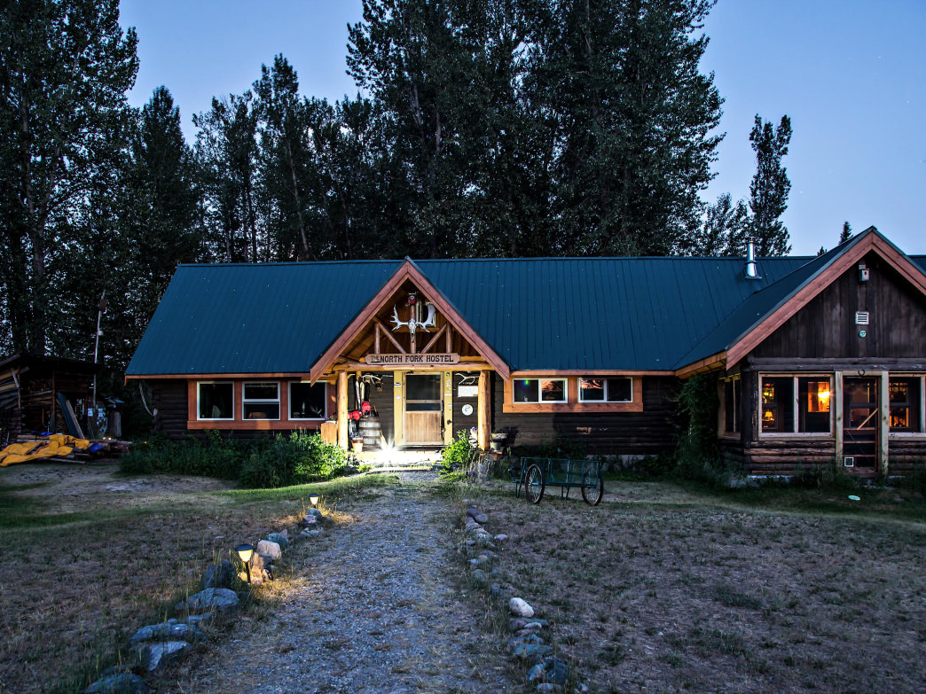 At North Fork Hostel near Glacier National Park, guests can bunk up in the main cabin or unique accommodations like a refurbished trailer from the 1950s.