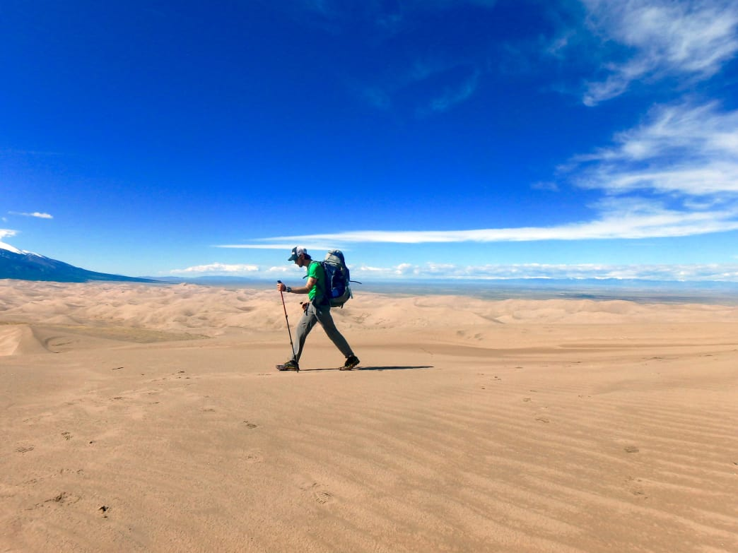 You can hike on the sand dunes year round in Alamosa, but fall's cooler temps make it one of the most inviting seasons to get out there.
