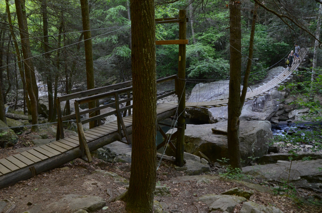 Hiking over Middle Creek across the 100 foot wooden suspension bridge.