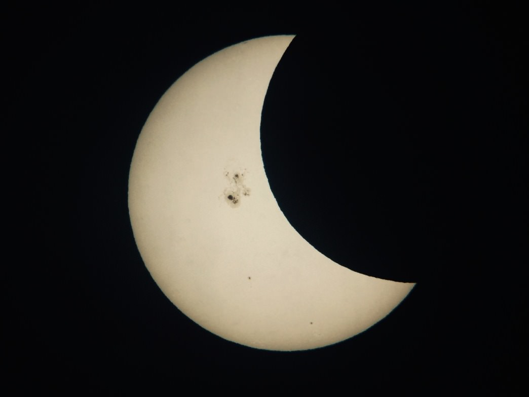 Looking through a telescope can get you super close to the skies — in this case, to a partial solar eclipse.