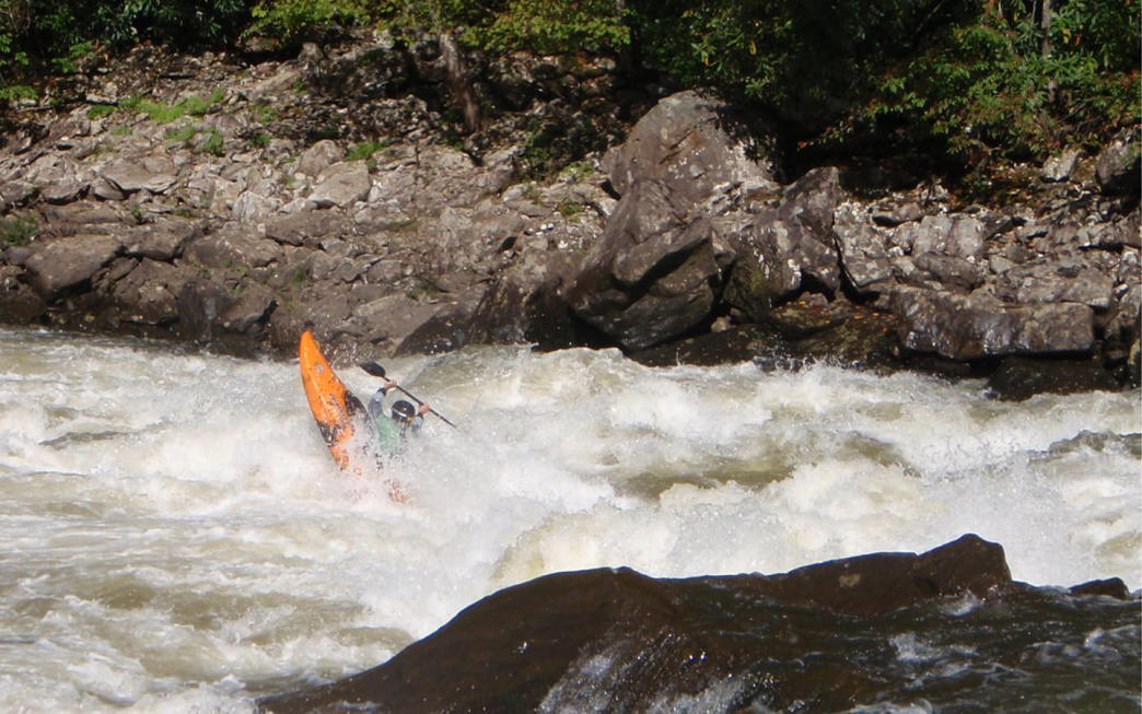 A kayaker takes on the Iron Ring rapid in the Upper Gauley.      Chris Amelung