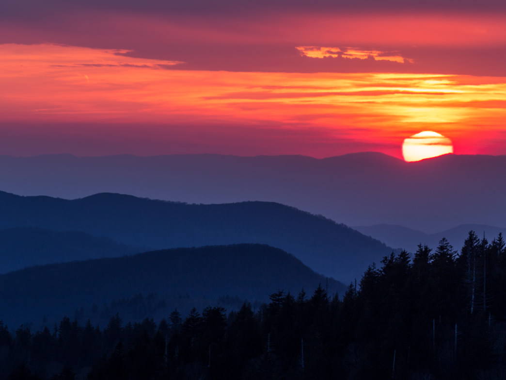 Clingmans Dome is the highest point in Great Smoky Mountains National Park, and its sunsets are superlative, too.