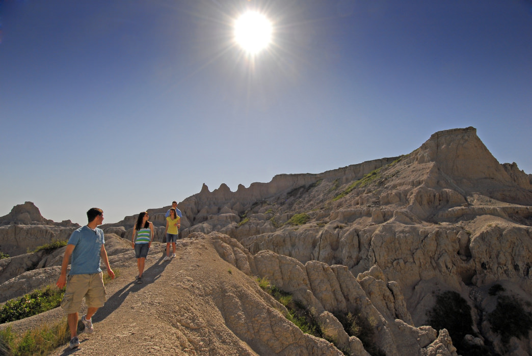 In Badlands National Park, the 1.5-mile Notch Trail will take you through an otherworldly landscape to reach hundred-mile views of the White River Valley.