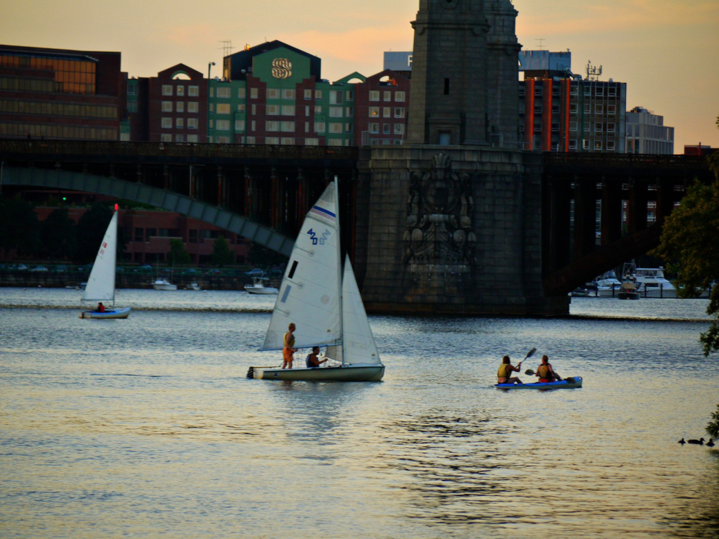 Boaters and kayakers enjoy an evening on the Charles